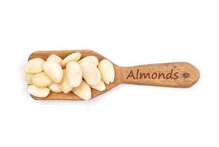 describable: Blanched almonds on shovel