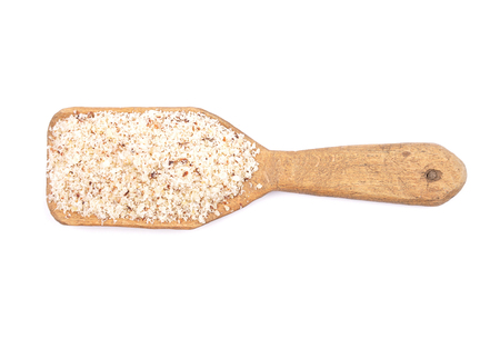 Hazelnuts powdered on shovel