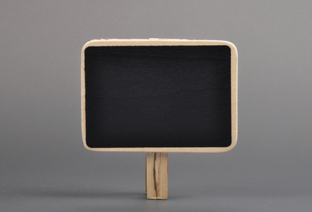 describable: Wooden plate with leg