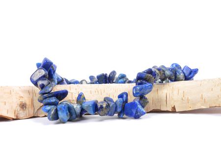 lapis: Splintered lapis lazuli chain on wood