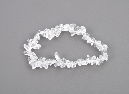 crystal background: Splintered rock crystal chain on gray background Stock Photo