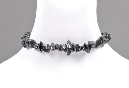 Splintered hematite chain on neck Stock Photo
