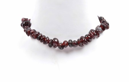 shiver: Splintered garnet chain on  neck Stock Photo