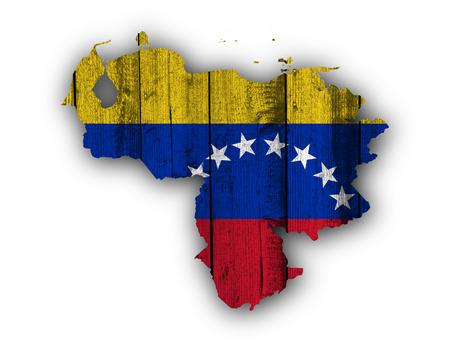 bandera de venezuela: Map and flag of Venezuela on weathered wood Foto de archivo
