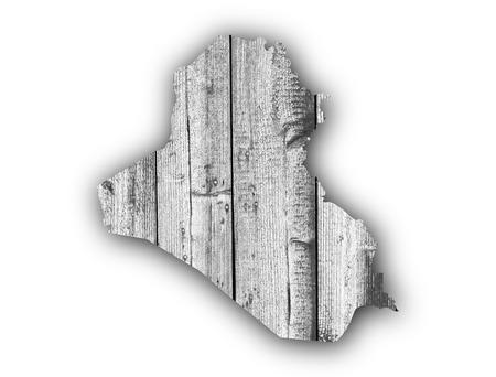 iraq: Map of Iraq on weathered wood