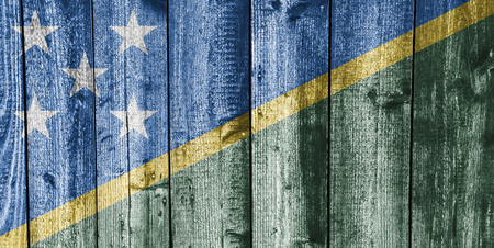 Flag of the Solomon Islands on weathered wood