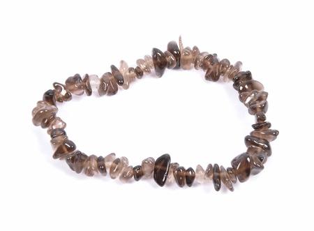 Splintered smoky quartz chain on white background Stock Photo