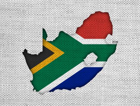 Carte et drapeau de l'Afrique du Sud sur vieux lin