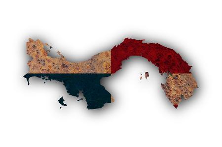 Mapa y bandera de Panamá sobre metal oxidado