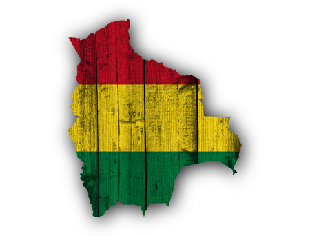 map bolivia: Map and flag of Bolivia on weathered wood