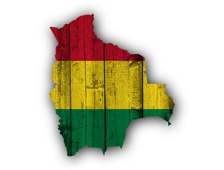 Mapa y bandera de Bolivia en madera desgastada