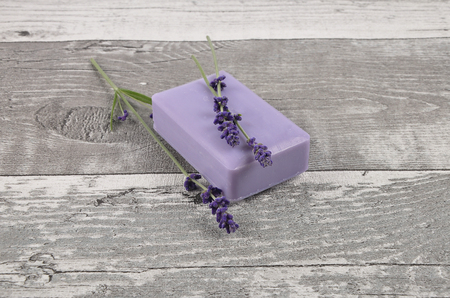 Soap and lavender on weathered wood