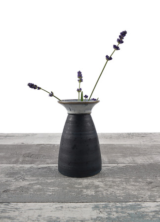 Vase with lavender on wood Stock Photo