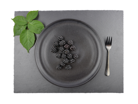 Blackberries on plate and shale