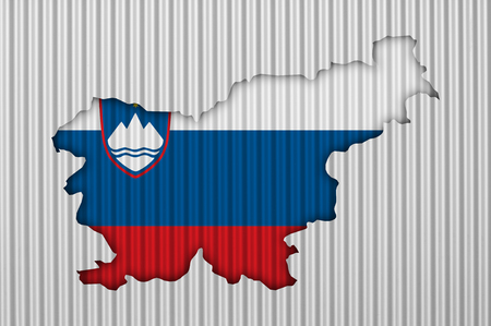 Map and flag of Slovenia on corrugated iron Standard-Bild