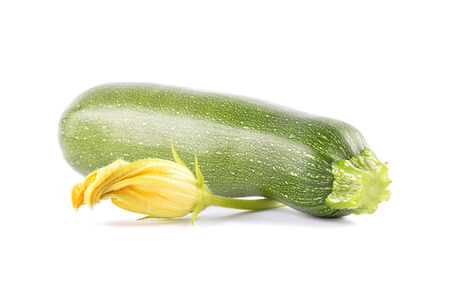 Zucchini and flower on white