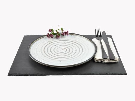 Oregano and table setting on slate isolated Stock Photo