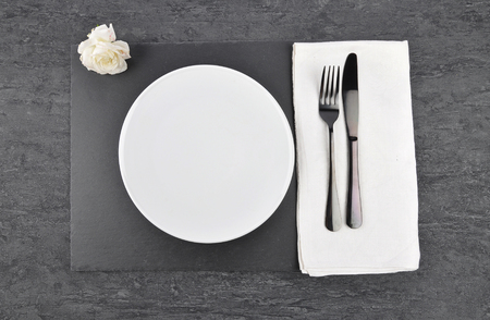 White rose and table setting on slate  Stock Photo