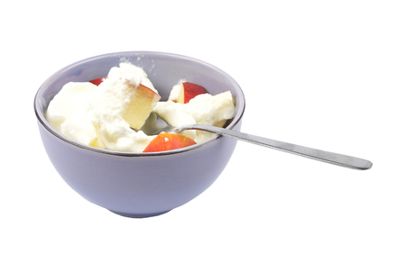 Bowl with apple and yoghurt