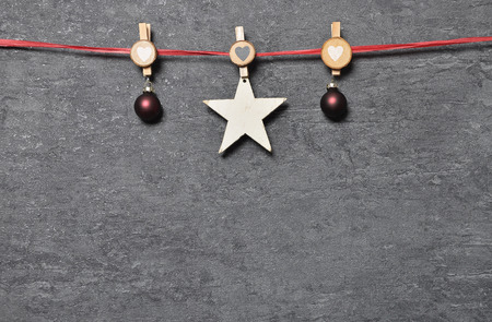 Background with Christmas tree decorations and wooden pegs