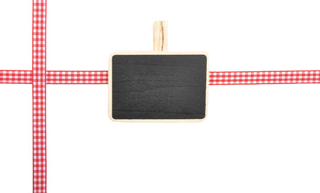Checked ribbon and blackboard on white background