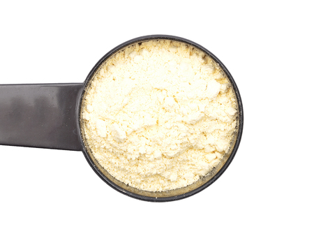Lupin flour in measuring spoon on white background Stock Photo