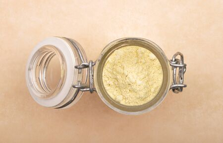 Lupin flour in open jar on brown background Stock Photo - 125286718