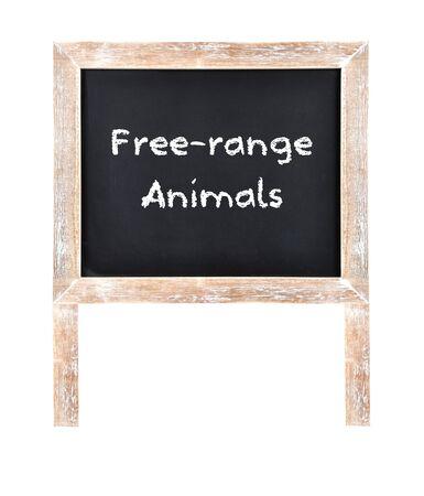 Warning free-range animals written on chalkboard isolated