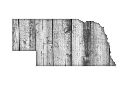 Map of Nebraska on weathered wood