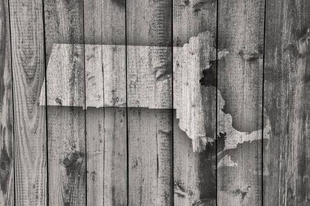 Map of Massachusetts on weathered wood