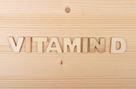 Term from wooden letters on pale wood