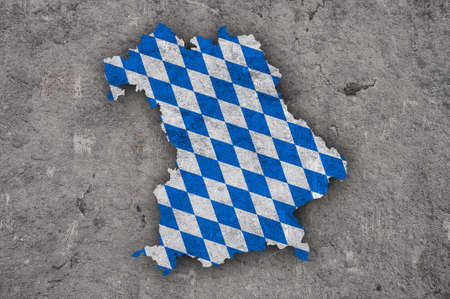 Map and flag of Bavaria on weathered concrete