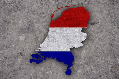 Map and flag of Netherlands on weathered concrete