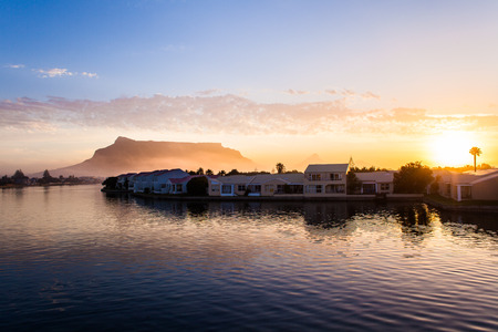 Cape Town houses on the River at sunset with Table Mountain