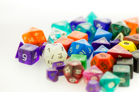 heap of role: Close up of a large pile of multicolored gaming dice on a white surface
