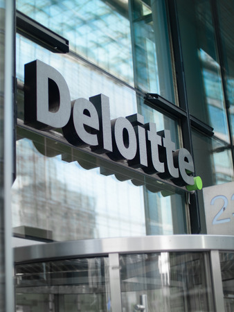 The Deloitte offices signage over the front door to their Berlin Building