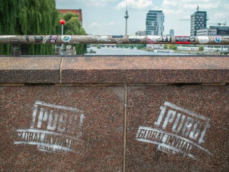 PlayerUnknown's Battlegrounds Global Invitational logo spray painted on a bridge