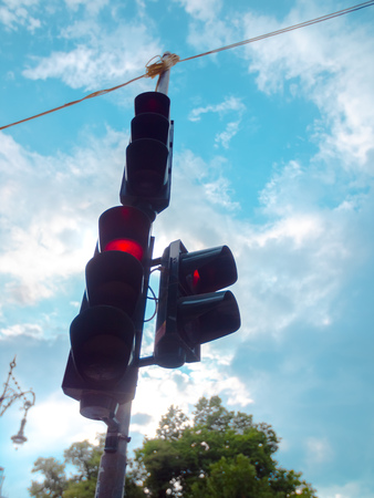 Low angle of a red traffic light in Berlin, Germany