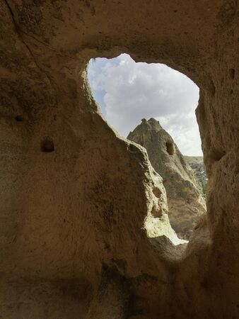 ancient window carved into sandstone caves in cappadocia Standard-Bild
