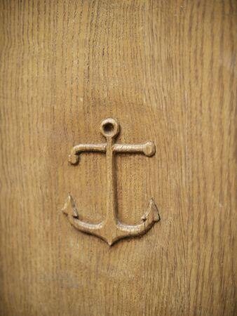 Anchor carved into wooden door Standard-Bild