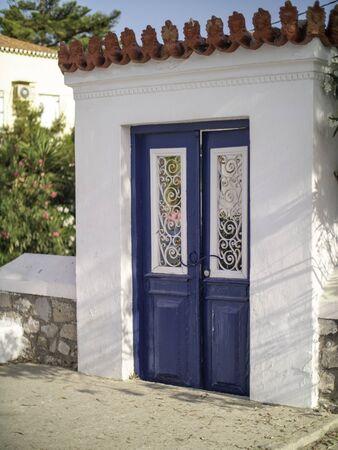 Blue painted wooden door in Greece