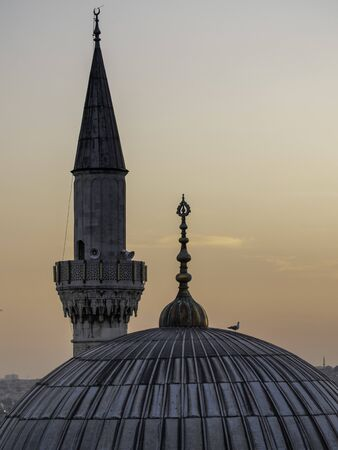 dome and tower of Istanbul mosque at sunset