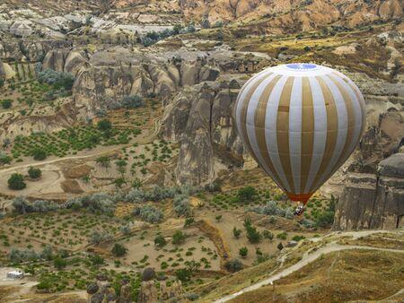 Hot Air Balloon over Cappadocia farm land in turkey