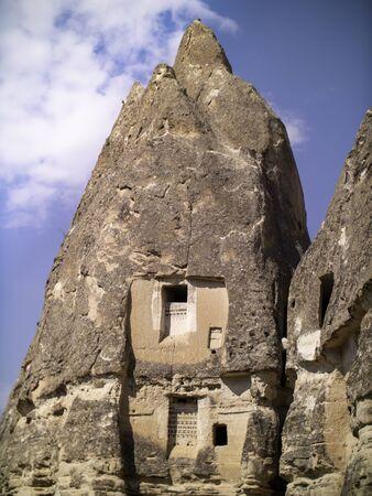carved sandstone cave houses in Cappadocia Standard-Bild