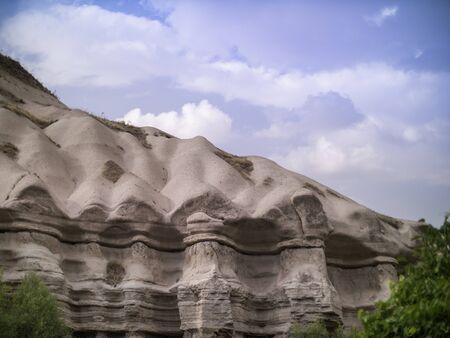wavey eroded sandstone cliffs in Cappadocia