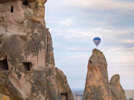 Hot Air Balloon over Cappadocia ruins in Turkey Editorial