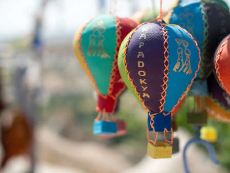 colorful toy plush hot air balloons at a market Editorial
