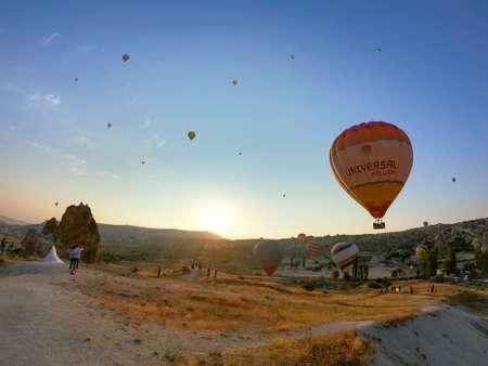 hot air balloon tours setting off over cappadocia desert Editorial