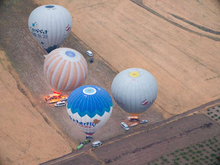 Hot Air Balloons getting ready to launch at dawn