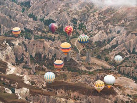 loads of Colorful Hot Air Balloons over Cappadocia desert